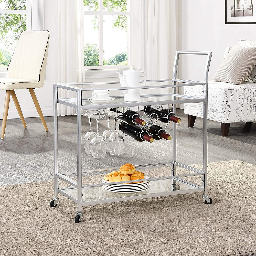 "FirsTime & Co. Delilah Silver Bar Cart, 32"" H x 15"" W x 12.25"" D - SIZE MATTERS – Our FirsTime & Co. Delilah Silver Bar Cart has a 32"" height, 15"" width and 12.25"" depth, allowing it enough room to hold your wine and snacks and making it convenient enough to place in any room. IT'S IN THE DETAILS – This silver bar cart is a versatile piece with a metal frame and glass shelves, with racks on the second tier that can hold up to 6 wine glasses and 5 compartments for wine bottle storage. The top is open to allow you to set drinks and snacks on top, and it comes with 4 metal wheels for easy maneuvering. MORE THAN IT SEEMS – This bar cart can also work as a coffee cart, dining storage, or even as an end table. THE PERFECT TOUCH – This bar cart is a gorgeous accent piece for any kitchen or bar. OUR PROMISE – We at FirsTime & Co. take great pride in and stand behind our products with a 30-Day Limited Manufacturer Warranty."
