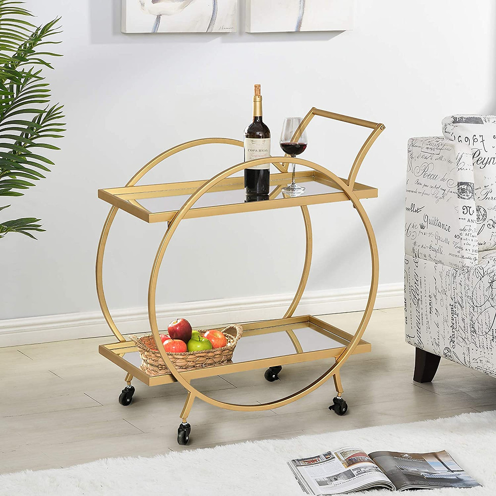 "FirsTime & Co. Gold Odessa Bar Cart - SIZE MATTERS – Our FirsTime & Co. Gold Odessa Bar Cart has a 32"" height, 28"" width and 14.25"" depth, allowing it enough room to hold your drinks and snacks as well as making it convenient enough to place in any room. IT'S IN THE DETAILS – This gold bar cart is a versatile piece with a gold metal frame and 2 glass mirror shelves. The open design allows you to set drinks and snacks on each level, and comes with four metal wheels for easy manuvering. MORE THAN IT SEEMS – This bar cart can also work as a coffee cart, dining storage, or even as an end table. THE PERFECT TOUCH – Our FirsTime & Co. Gold Odessa Bar Cart is a gorgeous, functional accent piece for any kitchen or bar., OUR PROMISE – We at FirsTime & Co. take great pride in and stand behind our products with a 30-Day Limited Manufacturer Warranty."