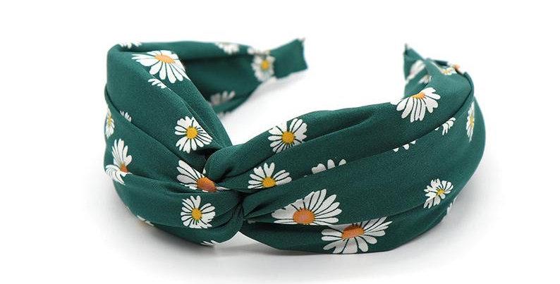 Green fabric headband with pretty daisy print