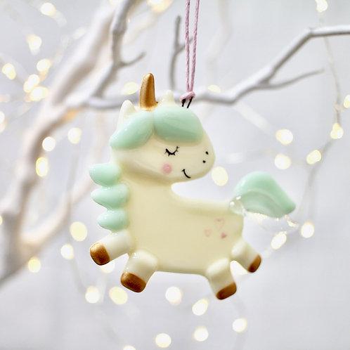 Новогодняя игрушка 'Единорог в оглядке' (мятный)
