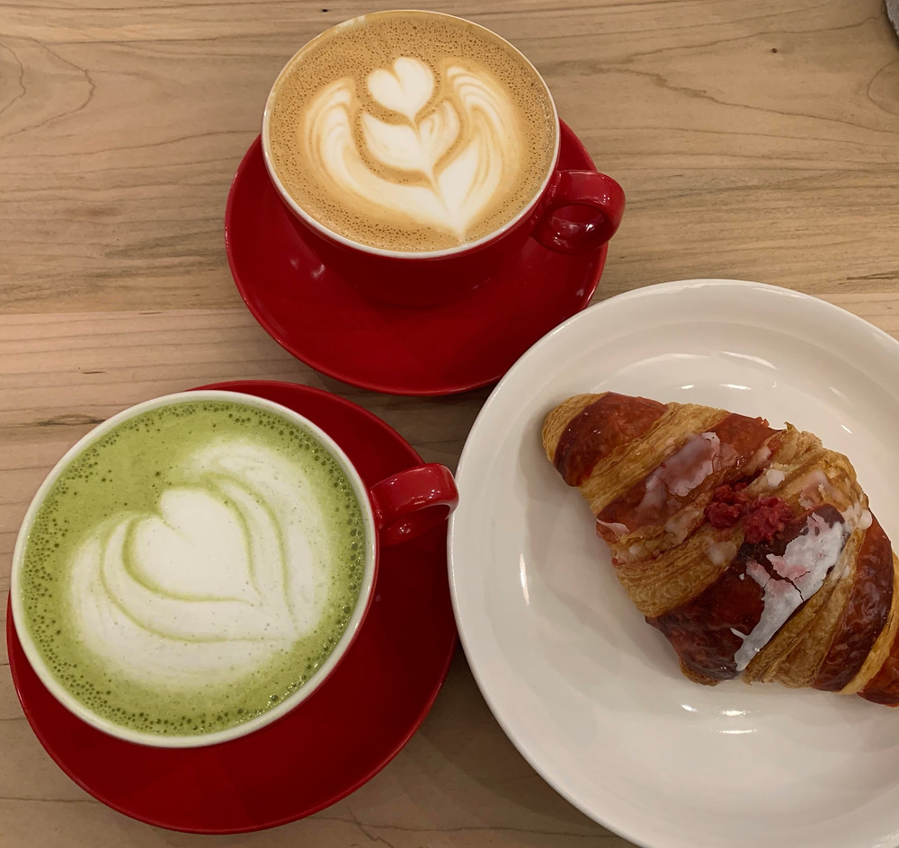 white chocolate matcha latte, butter toffee crunch latte, and a raspberry swirl croissant