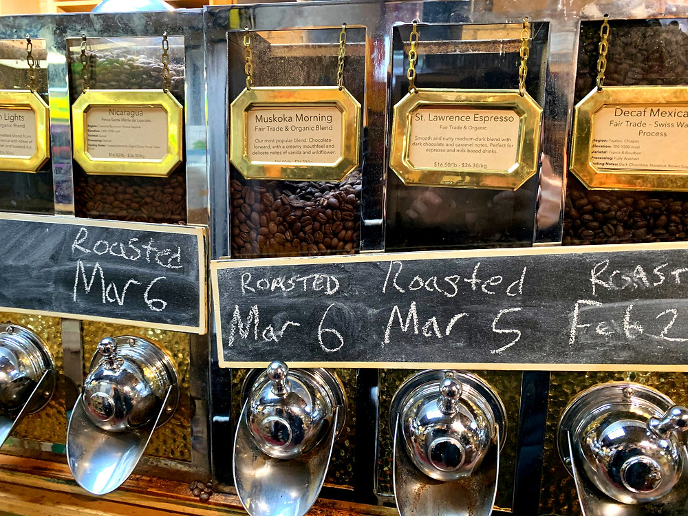 Freshly roasted coffee beans with varying roast dates for sale at St Lawrence Market Toronto