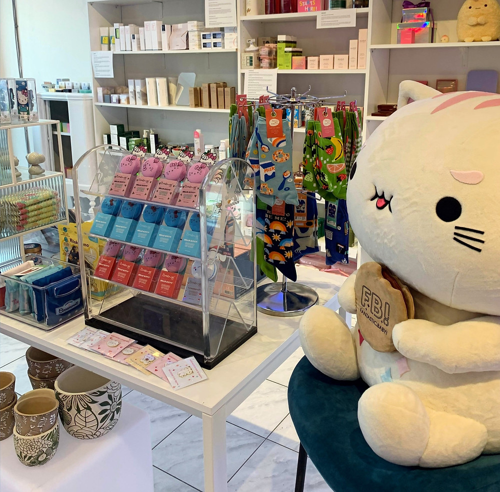 Fantastic Baby Cafe mascot MoChiChi with local and imported gifts for sale in shop