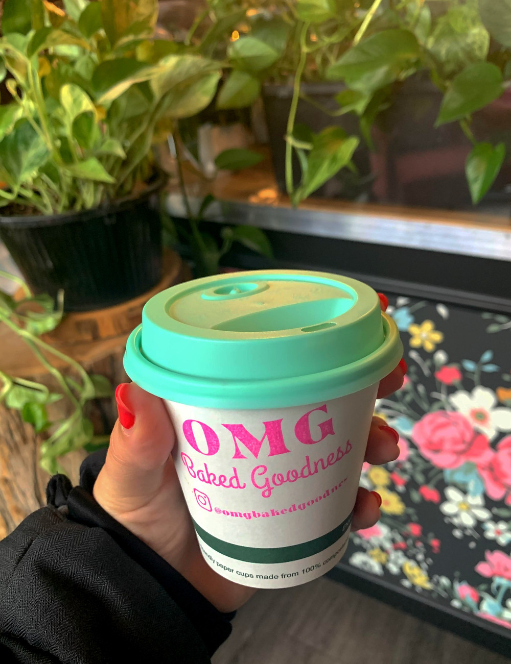 Coffee cup and plants at OMG Baked Goodness Toronto