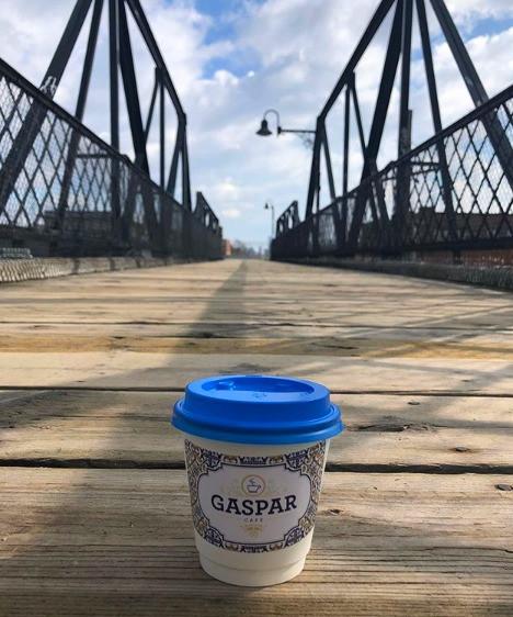 Gaspar Cafe coffee cup on West Toronto Railpath bridge