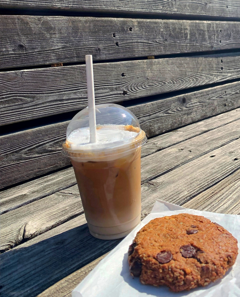 Full Stop Toronto coffee shop iced latte and cookie