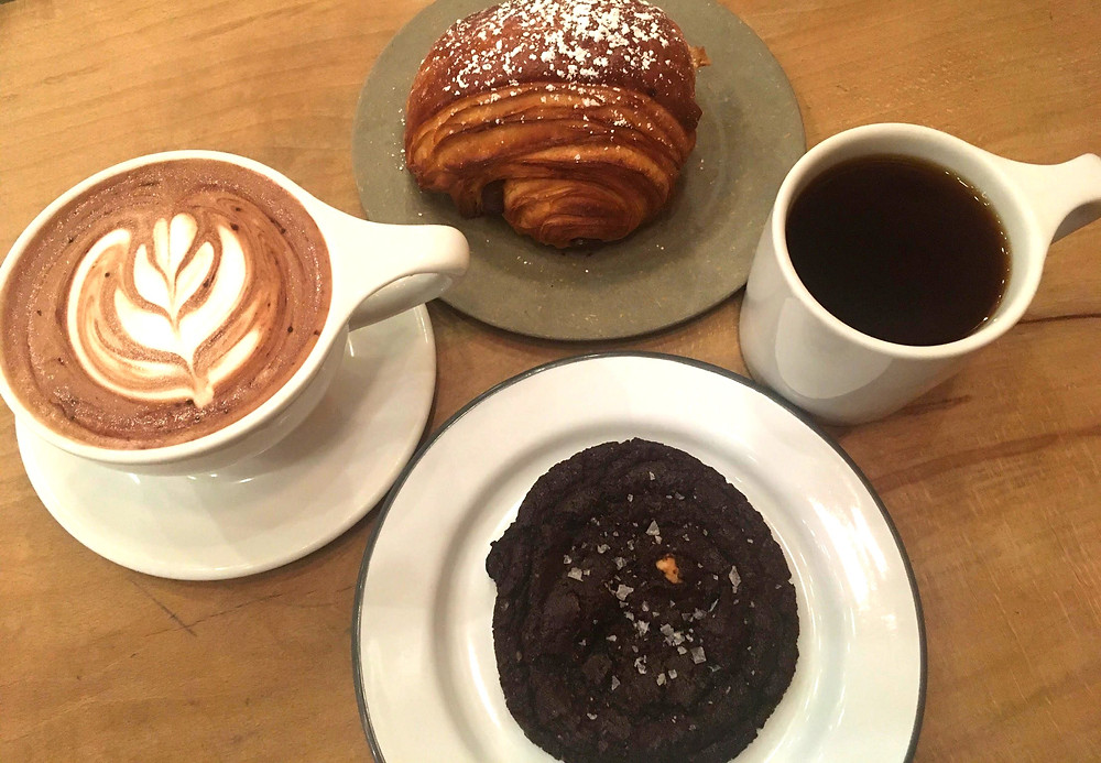 Clockwise: pain au chocolat, featured pour over, double chocolate sea salt cookie, house made hot chocolate from Matchstick Vancouver