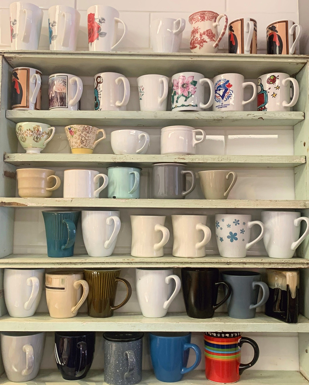 Assortment of vintage mugs at Crosscut Coffee sit-in cafe