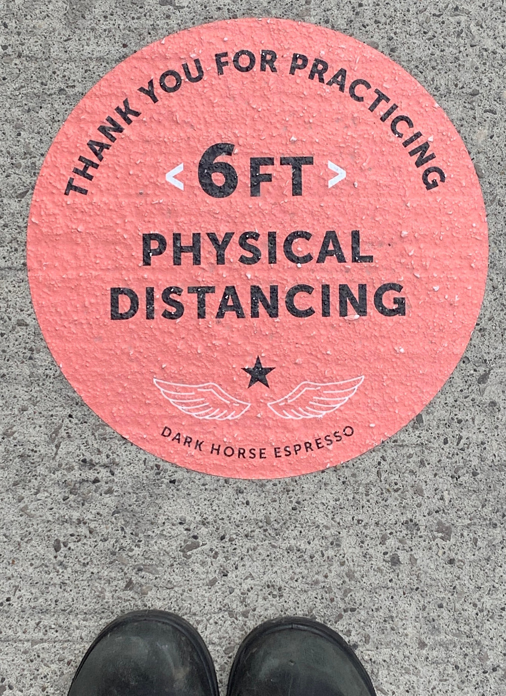 physical distance stickers in Yorkville Toronto for Dark Horse Coffee Automat