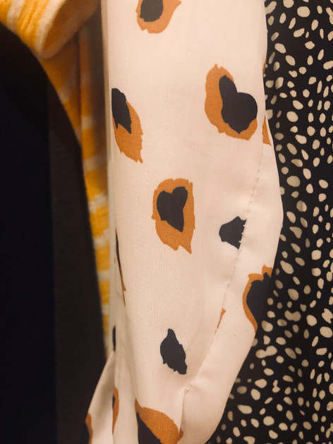 Heart on my sleeve. I've had this dress shirt in my closet for the longest time and noticed a heart in the leopard print!