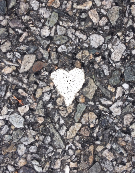 Heart of white paint. Found on the asphalt while crossing the street near my college. It was so small, I almost missed it!