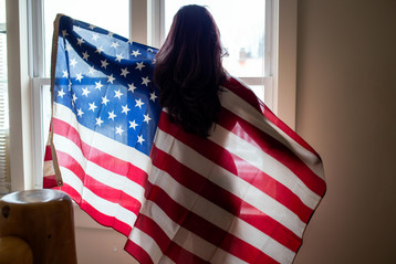 A woman with the American Flag