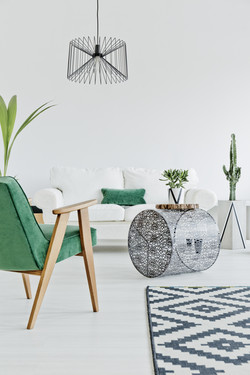 Light home interior with green chair, carpet and sofa