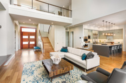 Beautiful and large living room interior with hardwood floors and vaulted ceiling in new luxury home