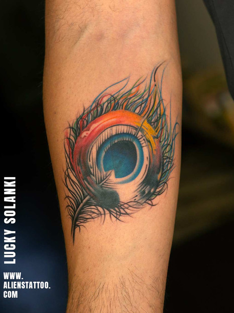 peacock-feather-tattoo-at-aliens-tattoo