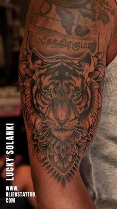 realistic-tiger-tattoo-by-lucky-solanki-aliens-tattoo