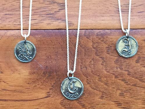 Fine silver initial