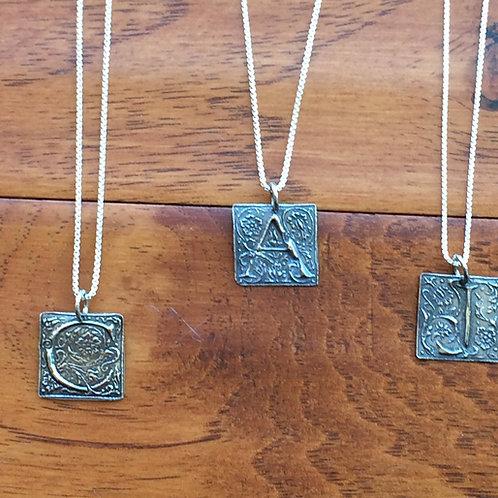 Fine silver square initial