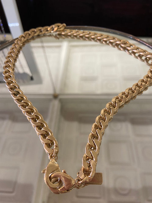 Bold curve chain mask necklace