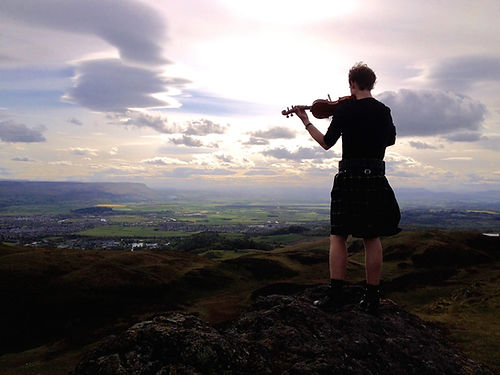 Steve Lesko, CrossBow Fiddler, playing Celtic muisc on top of Dumyat in Stirling, Scotland