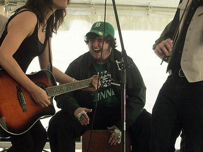 Ethan Noga playing cajon in the Celtic band, CrossBow, at Hennessy's Irish Pub in Muskegon, Michigan for St. Patrick's Day
