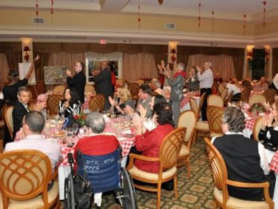 Guests show their appreciation to Dimensional Harmony students from Boynton Beach High School Choir.