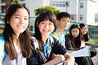 Group Of Teenage Students study in schoo