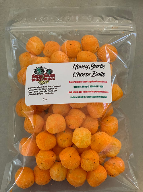 Honey garlic flavored puffy cheese balls in a clear bag with white Snacks Galore label