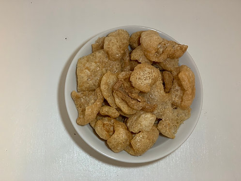 garlic adobo flavored pork rinds in a white bowl