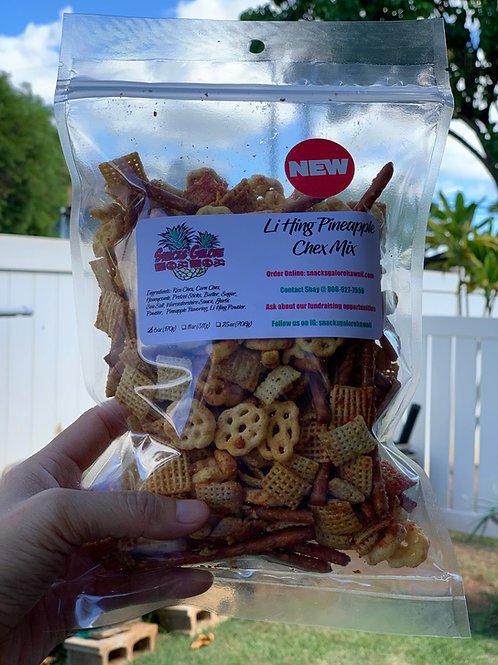 Hand holding up bag of clear bag of Li Hing Pineapple Chex Mix with Snacks Galore Hawaii label and round red new label