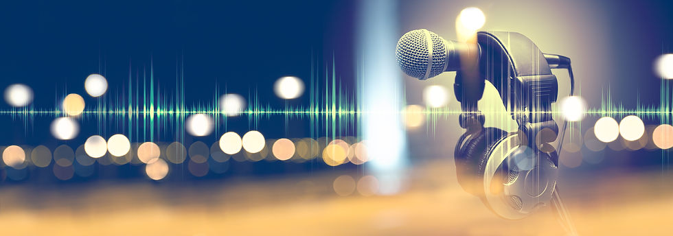 Microphone and headphones.Live music and blurred stage lights. Music background.jpg
