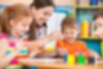 Cute little children drawing with teache