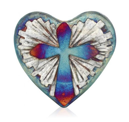 Heart shaped pottery with white silhouette of light rays from behind cross with irridescent finish in blues/purples/copper