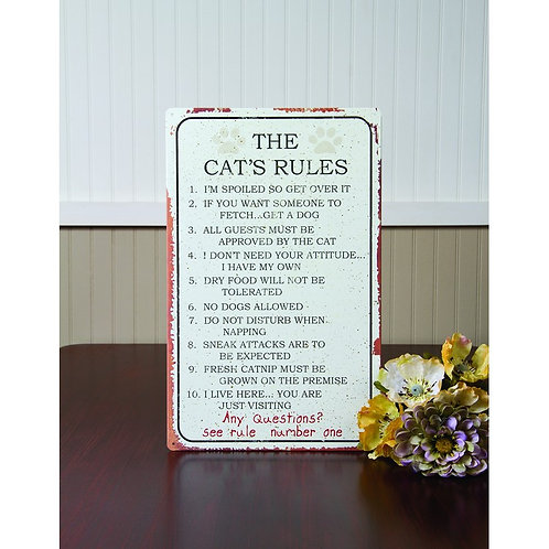"""Metal sign with """"The Cat's Rules"""" listed"""