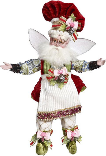 Fairy with beard, glass, apron and red velvet chef hat, white pants with pink bows on feet