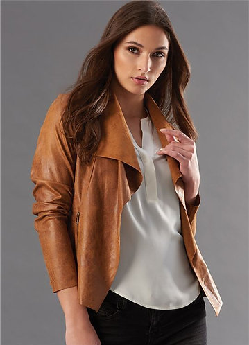 Tan colored faux suede cropped jacket open with no closure, side zip pockets