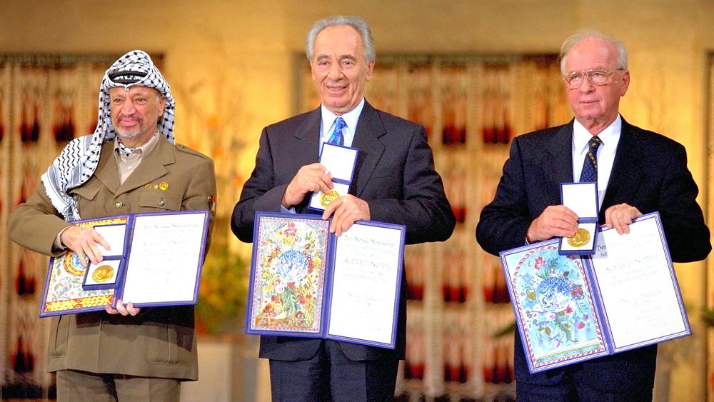 Illustration: The Nobel Peace Prize Laureates for 1994 in Oslo (Image credit: Saar Yaacov/Government Press Office of Israel) [CC BY-NC-SA 3.0] via Wikimedia