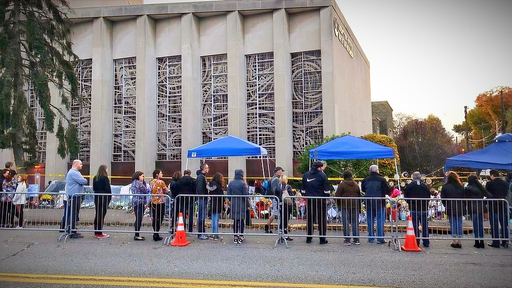 Illustration: People pay respects to victims at Tree of Life Synagogue by daveynin from United States [CC BY 2.0] via Wikimedia