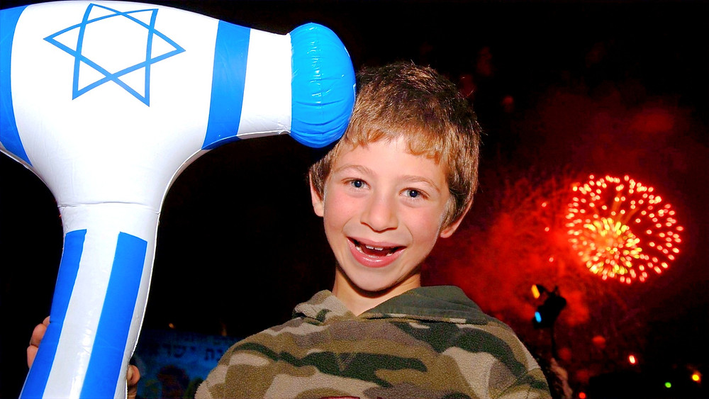 Illustration: Independence Day Celebrations In Jerusalem (Ishay Ohayon Holding A Plastic Hammer) (Image credit: Avi Ohayon/Government Press Office of Israel)