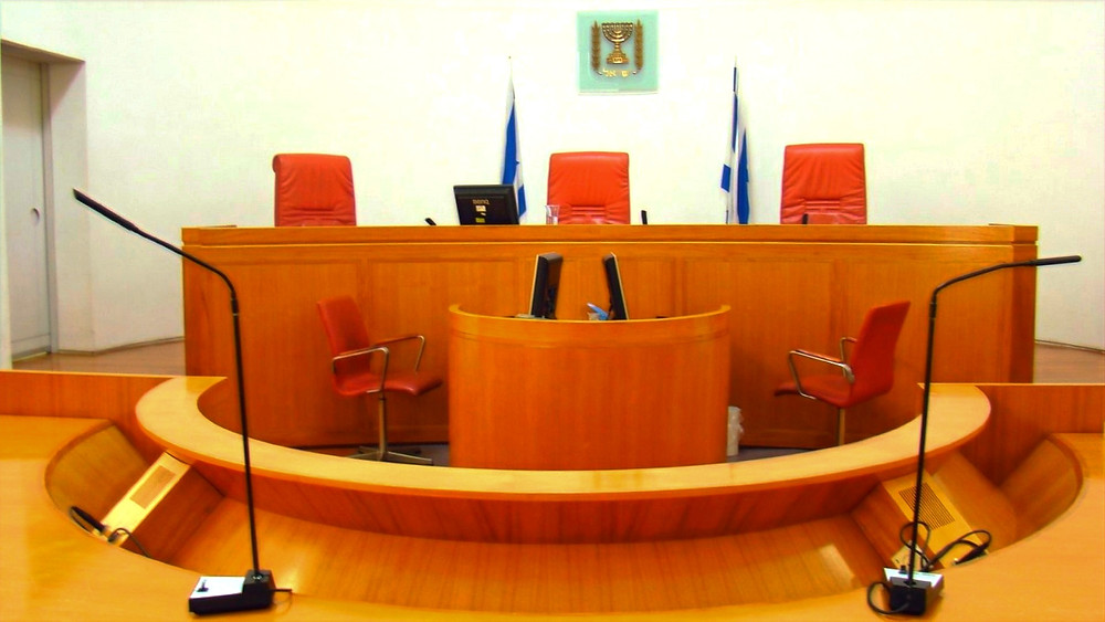 Illustration: Courtroom in the Israeli Supreme Court building by Anita Gould [CC BY-NC 2.0] via Flickr