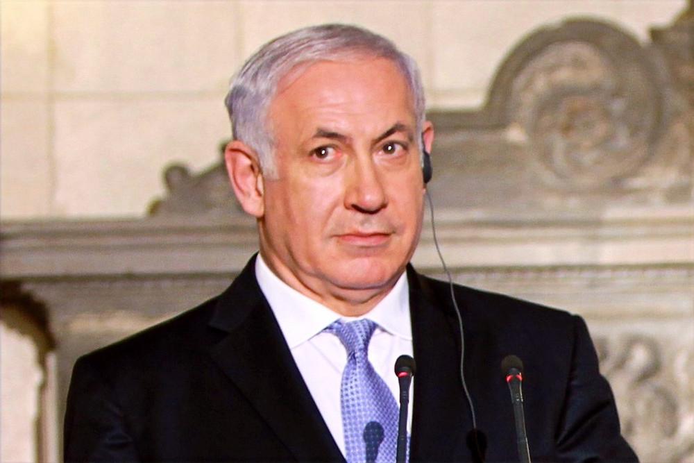 Illustration: Benjamin Netanyahu by MathKnight - Own work based on File:Flickr - Benjamin Netanyahu with Greek PM - 01.jpg [CC BY-SA 4.0] via Wikimedia