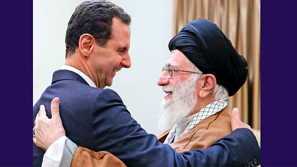 Illustration: Iranian Leader Ali Khamenei meets Syrian President Bashar al-Assad by Fars News Agency [CC BY 4.0] via Wikimedia