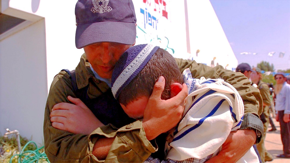 Illustration: A soldier comforts a resident during evacuation of Gush Katif community of Morag by Israel Defense Forces [CC BY-NC 2.0] via Flickr