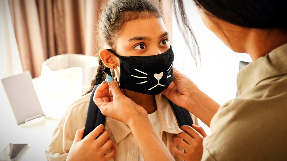 Illustration: Putting on a Child's Mask by August de Richelieu from Pexels