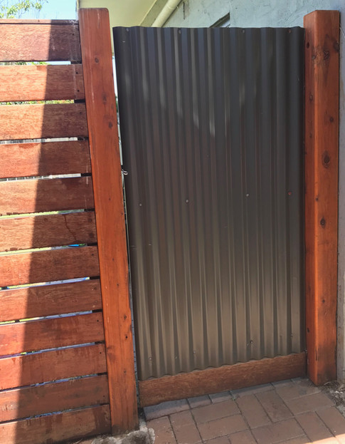 Colorbond Single Gate With Merbau Decking Fence.