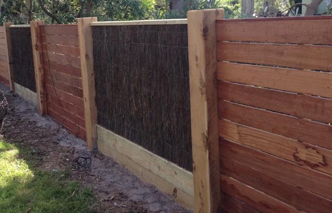 Brush & Merbau Decking Fence With Exposed Posts & Capping.
