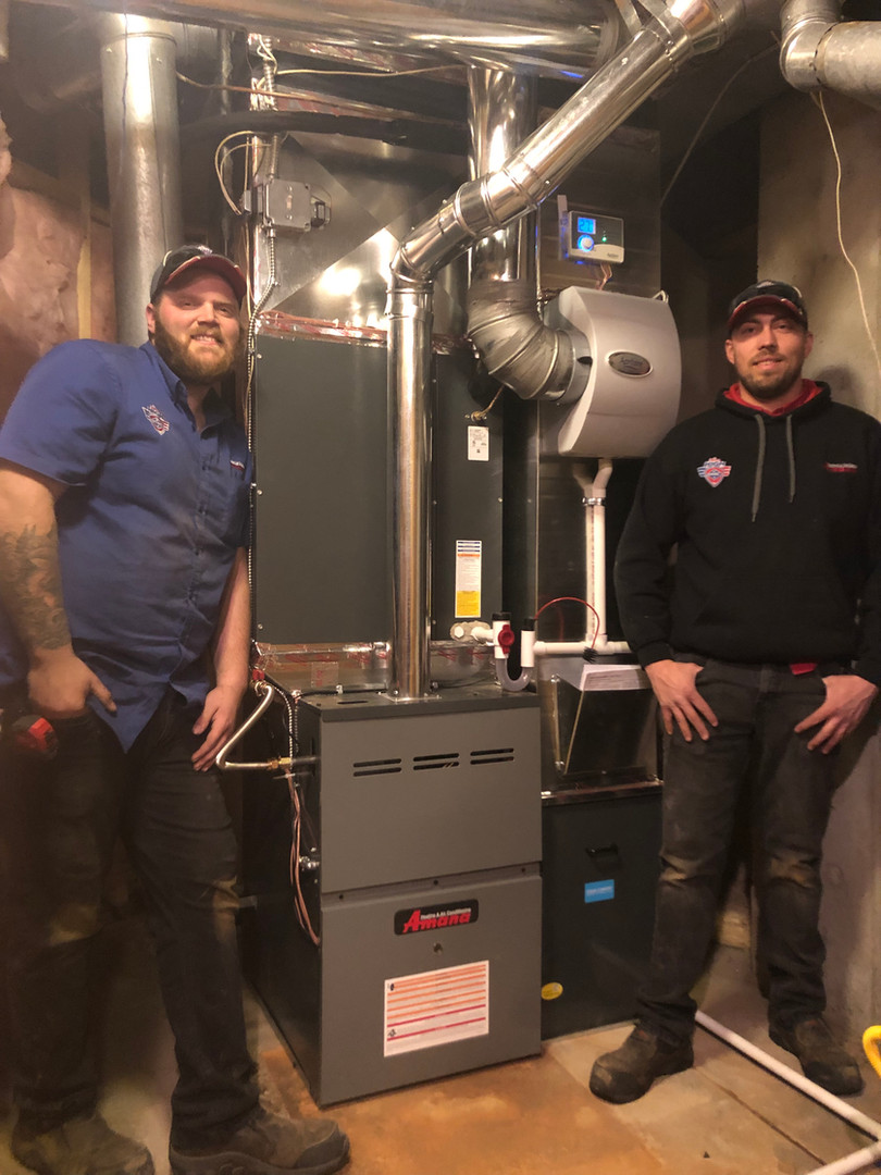 After: Aim High HVAC techs with new Amana furnace.