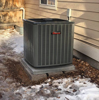 After: The new Amana A/C is installed and ready for the summer heat.