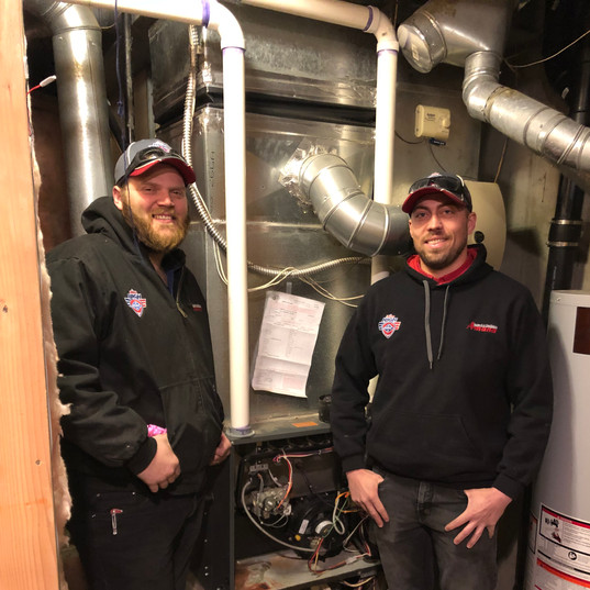 Before: Our team replacing an old furnace.