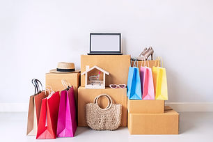 Colorful shopping bag with stack of cardboard boxes and fashion items at home, Website onl